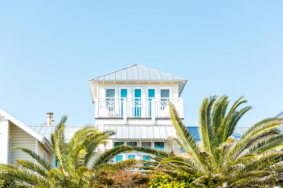 Personal Insurance - Modern Florida Home with Palm Trees in Front